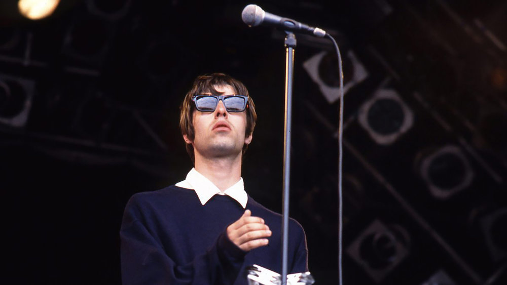Liam Gallagher, Oasis frontman, wearing Kirk Originals at 1994's Glastonbury Festival.