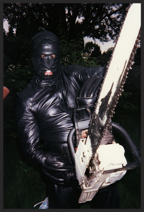 The chainsaw wielding gimp coming after Massive Attack in the Riisngson promo video directed by Walter Stern in June 1997.