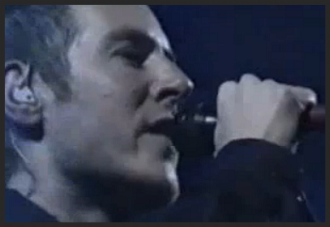 Photo still of 3D performing Reflection live at the Ancienne Belgique, Brussels in 1998.  Watch the video on Youtube.