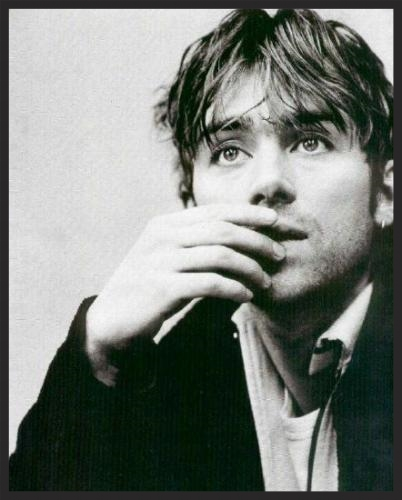 Damon Albarn, whose backing vocals on Small Time Shot Away were reduced to a barely audible background humming noise, was credited as 2D (his Gorillaz moniker)on the 100th Window.