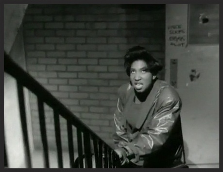 A towering apartment complex is the setting for the everyday drama of a woman trying to get home. Shara Nelson pictured in the promo video for Safe From Harm, directed by Baillie Walsh at a disused tower block in London, April 1991.