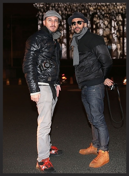 "Darren Aronofsky and JR outside their public outdoor art exhibit  ""The Standing March""  in Paris."