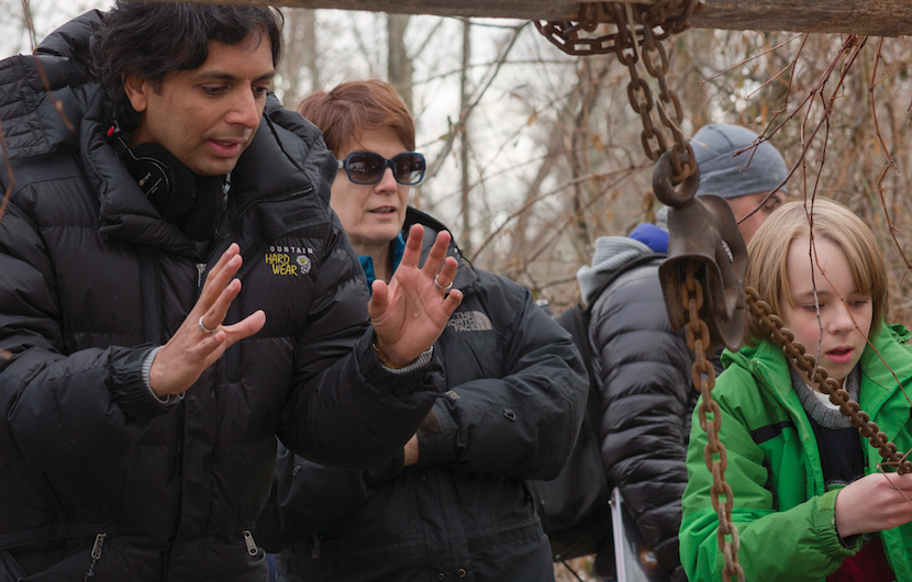 "Director M. Night Shyamalan, left, prepares for a scene during filming of his new thriller, ""The Visit."" Tara Matlock, of Bethlehem, was the film's assistant hair stylist.  (Universal Pictures Photo)"