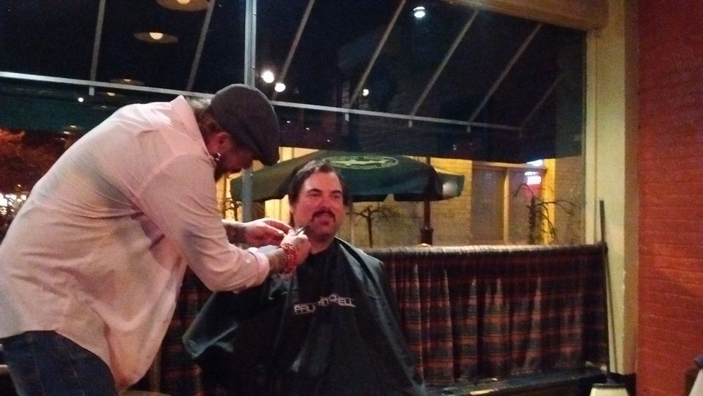 "Mike Roi, of Easton, loses his beard Tuesday during the ""Beards for Breasts"" fundraiser at Pearly Baker's Alehouse. (Lynn Ondrusek Photo)"