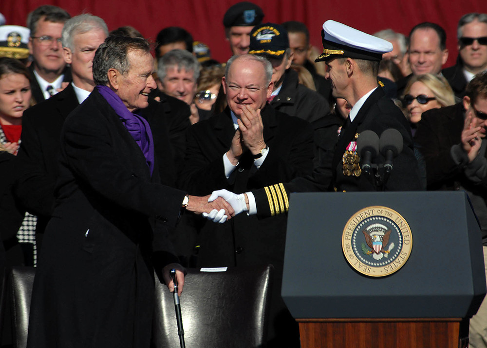 Wikimedia Commons Capt. Kevin E. O'Flaherty welcomes former President George H.W. Bush at commissioning of the aircraft carrier USS George H.W. Bush (CVN 77)
