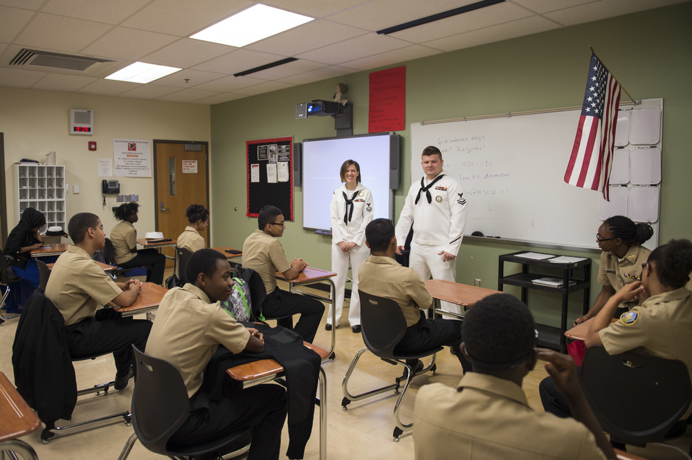 SYRACUSE, N.Y. (June 8, 2016) Aviation Structural Mechanic 2nd Class Stephanie Mertins, assigned to Navy Recruiting Station, Syracuse and Aviation Structural Mechanic (Safety) 2nd Class Gregory Shores, Navy Recruiting Station, Oswego talk with Navy Junior Reserve Officer Training Corps (NJROTC) at Fowler High School as part of Navy Week. (U.S. Navy photo by Mass Communication Specialist 1st Class Nardel Gervacio/Released)