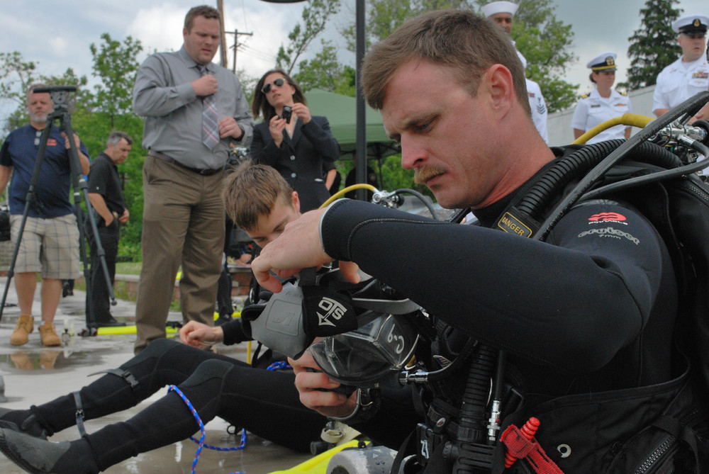 SYRACUSE, N.Y. (June 7, 2016) Navy Diver 2nd Class Erik Clark (DSW/SW) prepares for a dive during a training exercise with the Onondaga County Sheriff's Office Dive Team as part of Syracuse Navy Week.  (U.S. Navy photo by Mass Communication Specialist 2nd Class Adam D. Wainwright/Released)