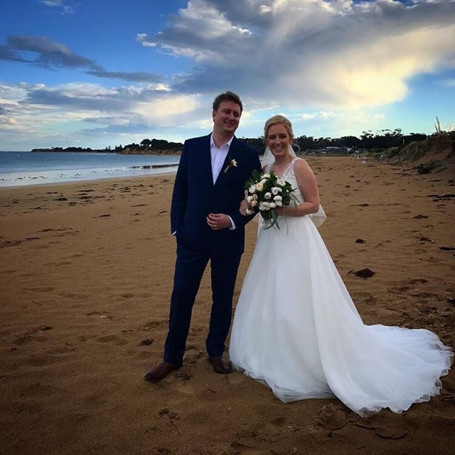 Rosie & Tom on Torquay beach, post thunderstorm (but a gorgeous blue sky to greet them post ceremony)