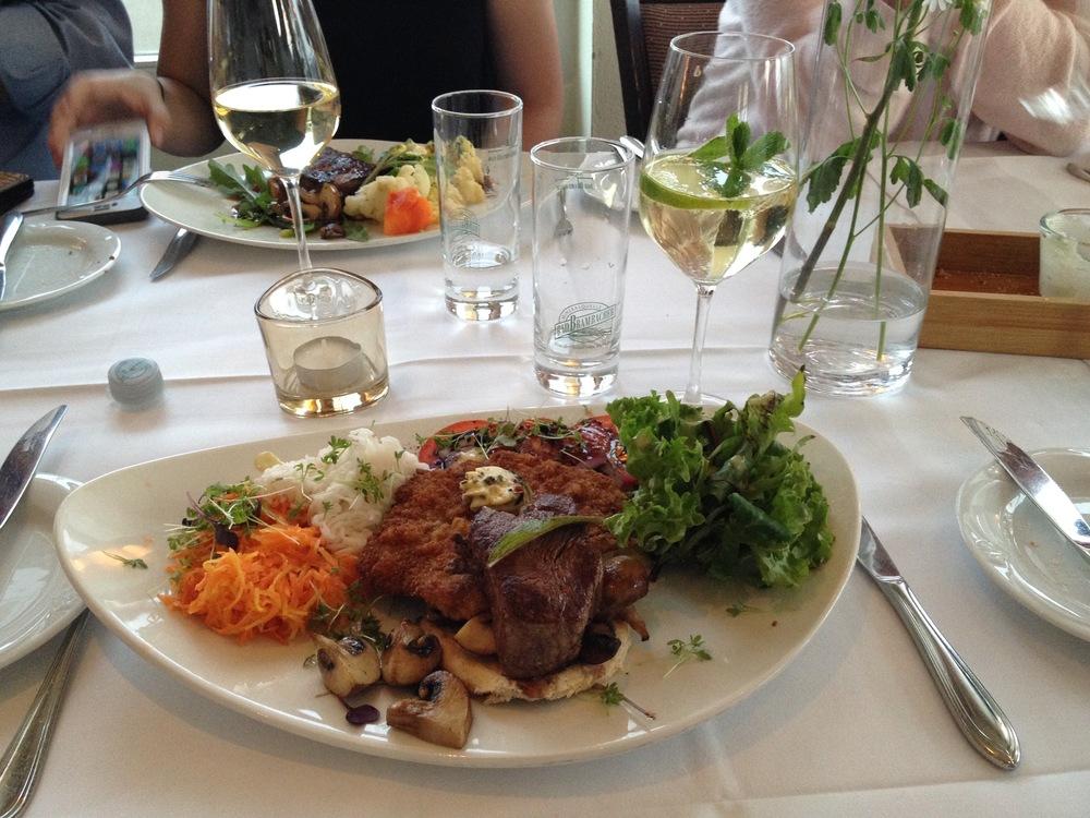 Schnitzel, pork medallions, mushrooms, and sauerkraut,with a Hugo(elderflower cocktail) to drink.