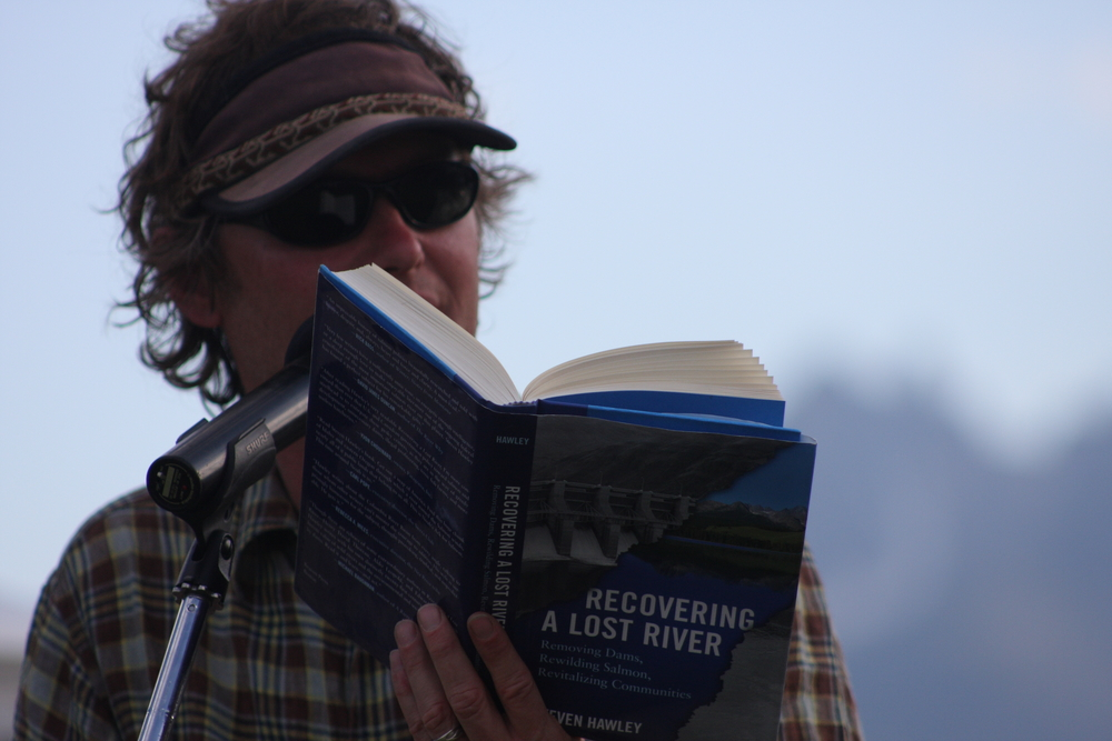 "Author Steven Hawley reads from his book, ""Recovering a Lost River,"" at the 2011 Sawtooth Salmon Fesitival in Stanley, Idaho. (Photo by Greg Stahl)"