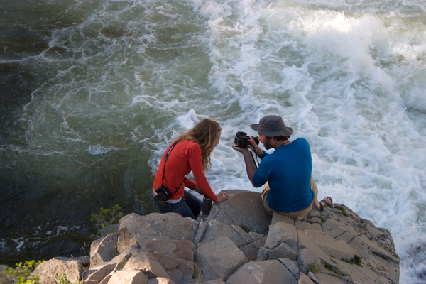 SOS Communications Manager Emily Nuchols and photographer Neil Ever Osborne review images. Photo by Greg Stahl