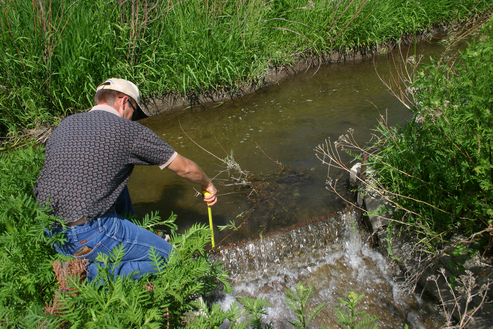 District 37/37M Watermaster Kevin Lakey measures water near the end of the 45 Canal in the Bellevue Triangle of southern Blaine County. The water, donated to the Wood River Legacy Project, is moving in new directions to benefit fish, wildlife and down-basin irrigators. (photo by Greg Stahl)