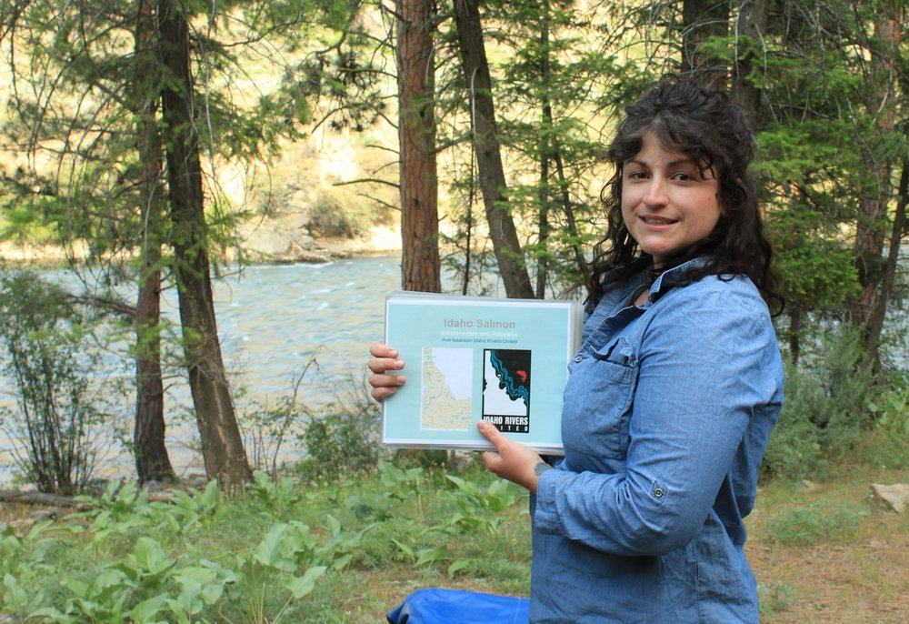 IRU Conservation Associate Ava Isaacson gives a presentation about wild salmon on the banks of the Middle Fork of the Salmon River.