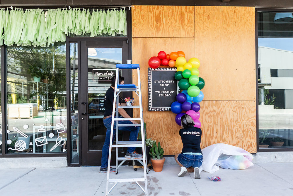 The Paper + Craft Pantry balloon garland install by ATX BUBBLES for Official Re-Opening Weekend.