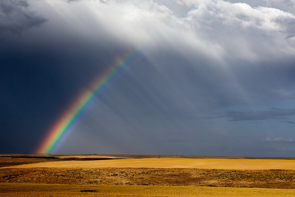 """""""Rainbow at Oregon Raceway Park, Grass Valley, OR"""" by Curt Smithis licensed under CC BY 2.0."""