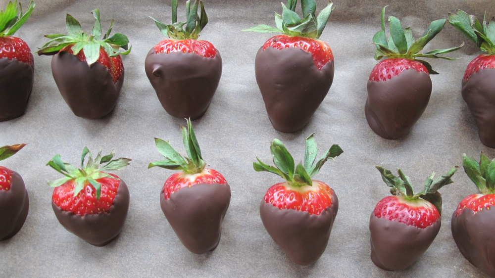 Nothing says romance like chocolate dipped strawberries (except for maybe a sip-o-champagne to go with it...hint hint).