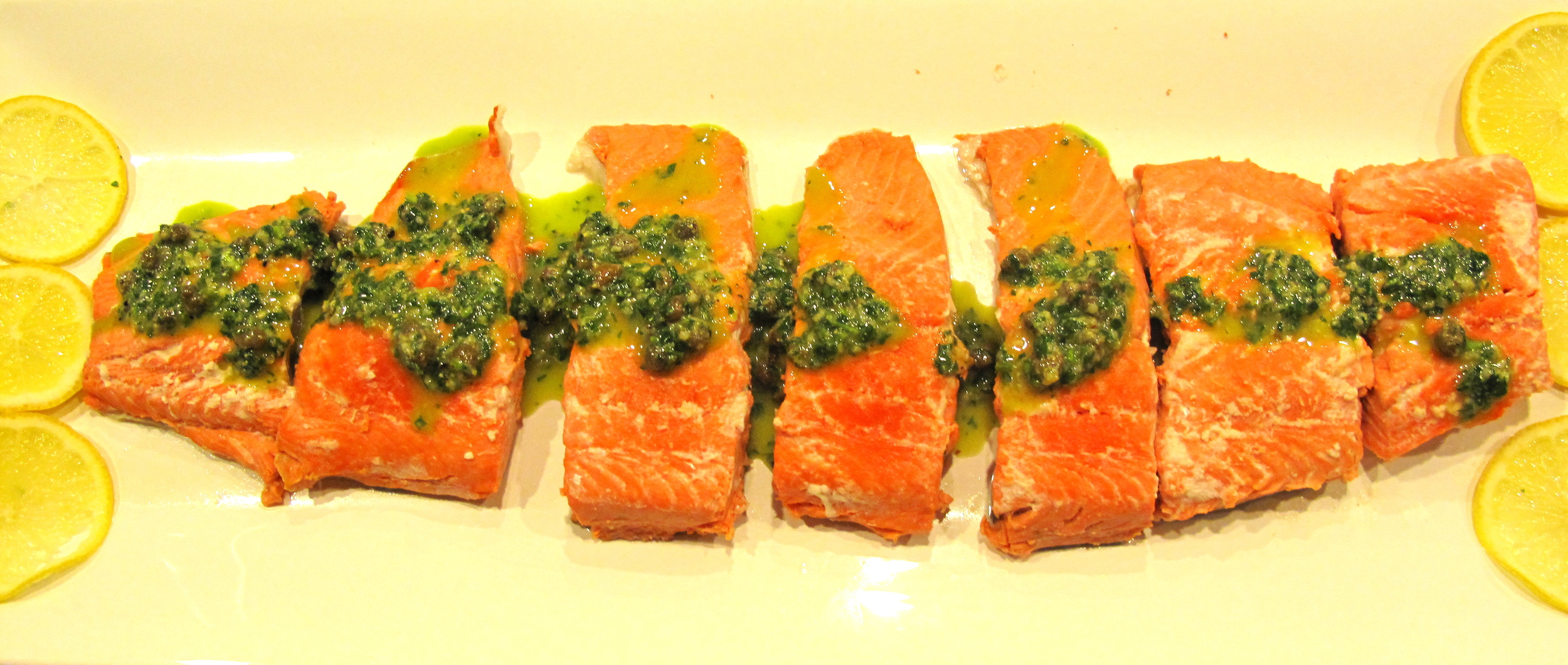Poached salmon is a simple dish that's great for parties and delicious the next day.