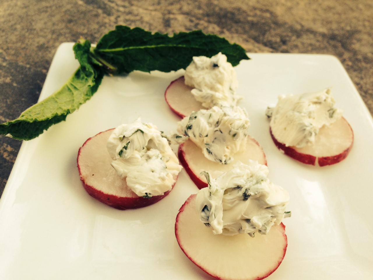 Enjoy the flavors of spring with garden fresh radishes and herbs in a swirl of cream cheese.