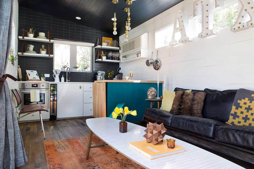 Yes! We did fit a mid-century surfboard coffee table in this tiny house!