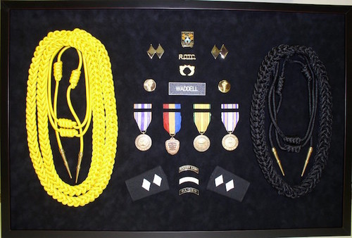 Mounting of Medals & Objects, no matter how highly dimensional, are a challenge we love to tackle. Let us shadowbox your mementos today.