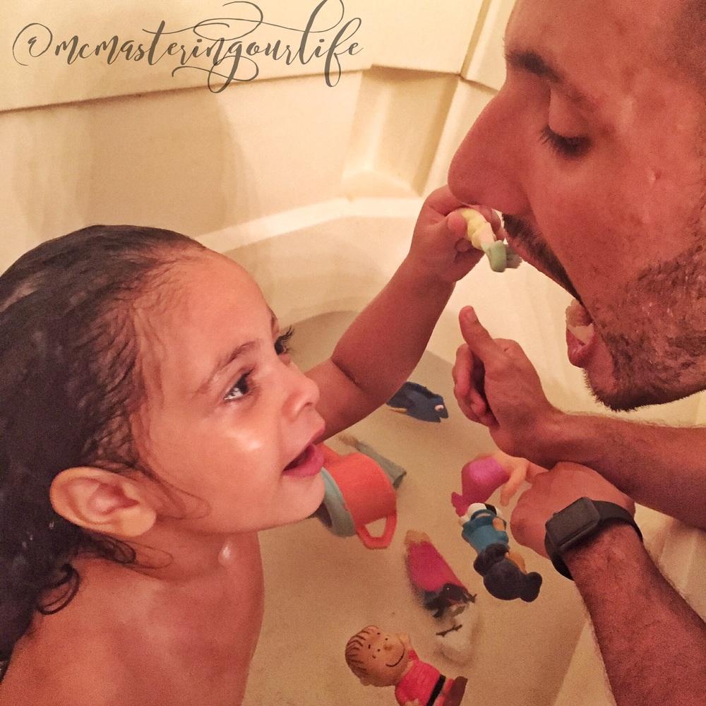 Multitasking- brushing and bathing.