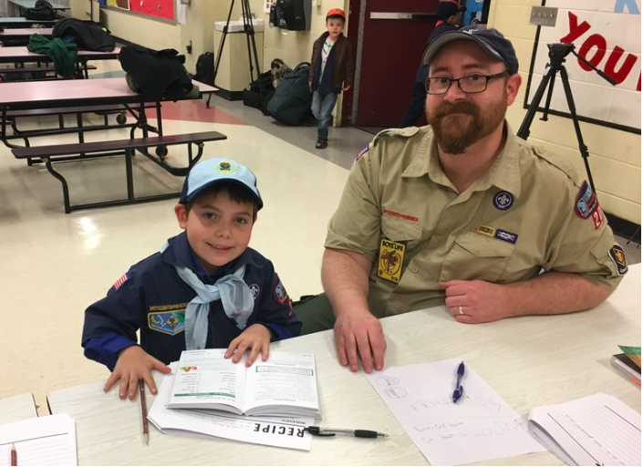 9-year-old Joe Maldonado with Pack 87 Cub Scout leader.