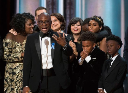 Director Barry Jenkins, producers, and cast members of Moonlight on stage to receive Best Picture                                           award.
