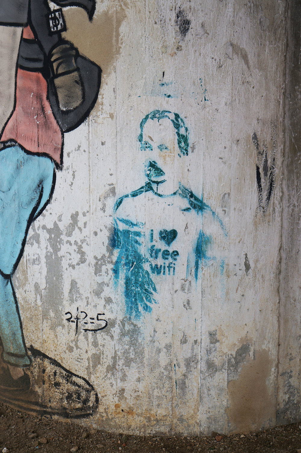 "The highly recognizable historical and cultural figure, José Martí, wearing a t-shirt that reads ""I Love Free Wifi.""  This was the only instance of this image that I was able to find that had not been censored."