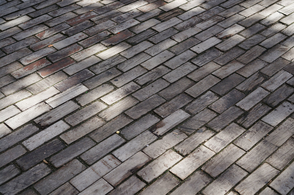 ...where the streets are paved in…wood!  I think the story goes that some rich guy's wife thought the cobbles were too loud so he ripped them all up and had the street paved in wood which was quieter.  So pretty!!