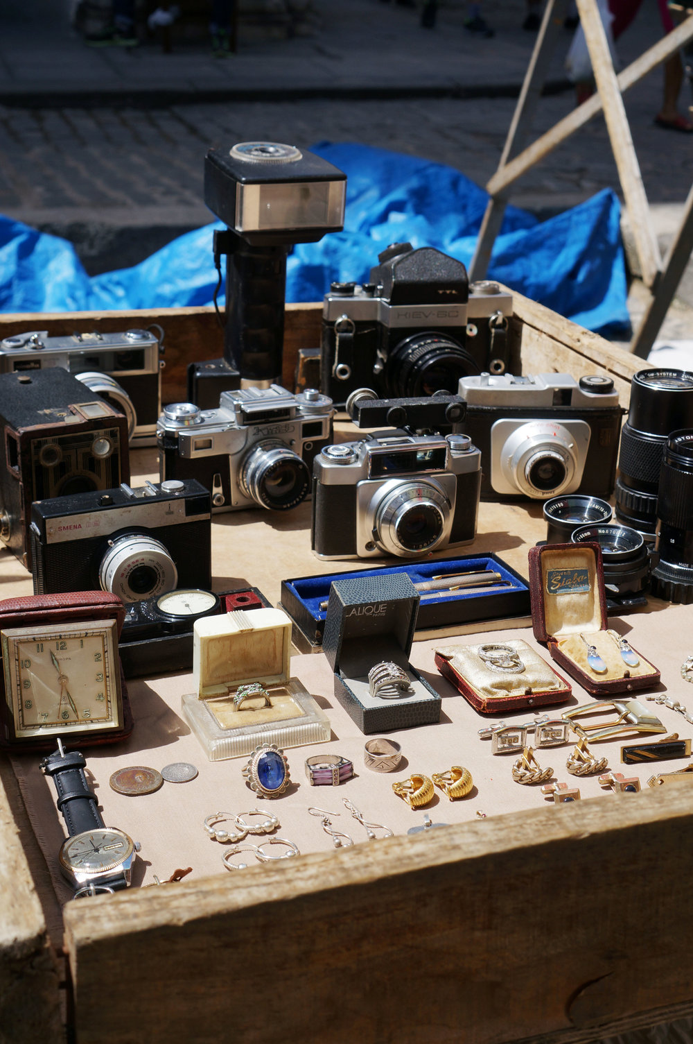 Old cameras and jewelry for sale in the Plaza de Armas.
