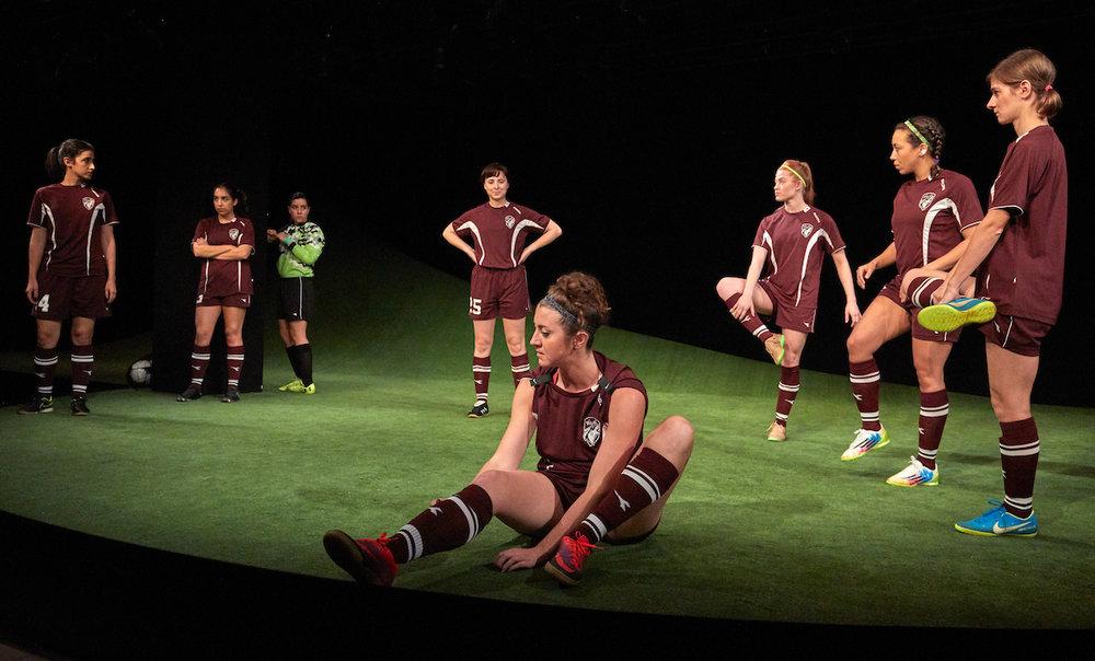 center: #7 (Olivia Hoffman), center rear: #25 (Emily Murphy); flanking, R to L: #14 (Rachel Kaplan), #13 (Dea Julien), #00 (Karla Gallegos), #11 (Shannon Keegan), #8 (Claire Saunders), #2 (Carolyn Cutillo)