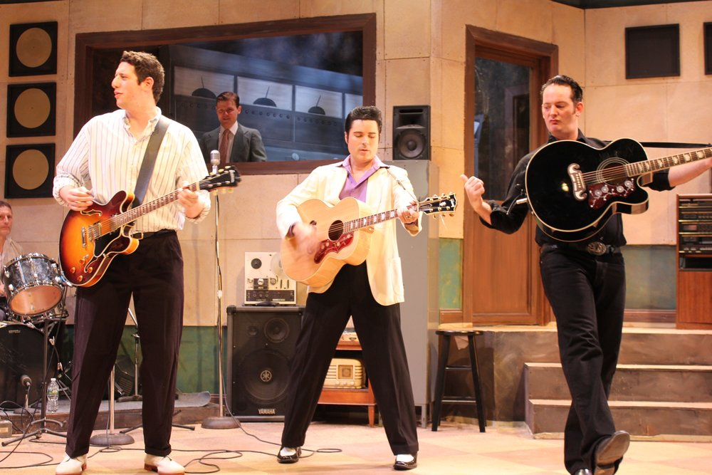 foreground: Carl Perkins (Jeremy Sevelovitz), Elvis Presley (Cole), Johnny Cash (Sky Seals); background: Fluke (Mark Ryan), Sam Phillips (Jason Loughlin), in the booth