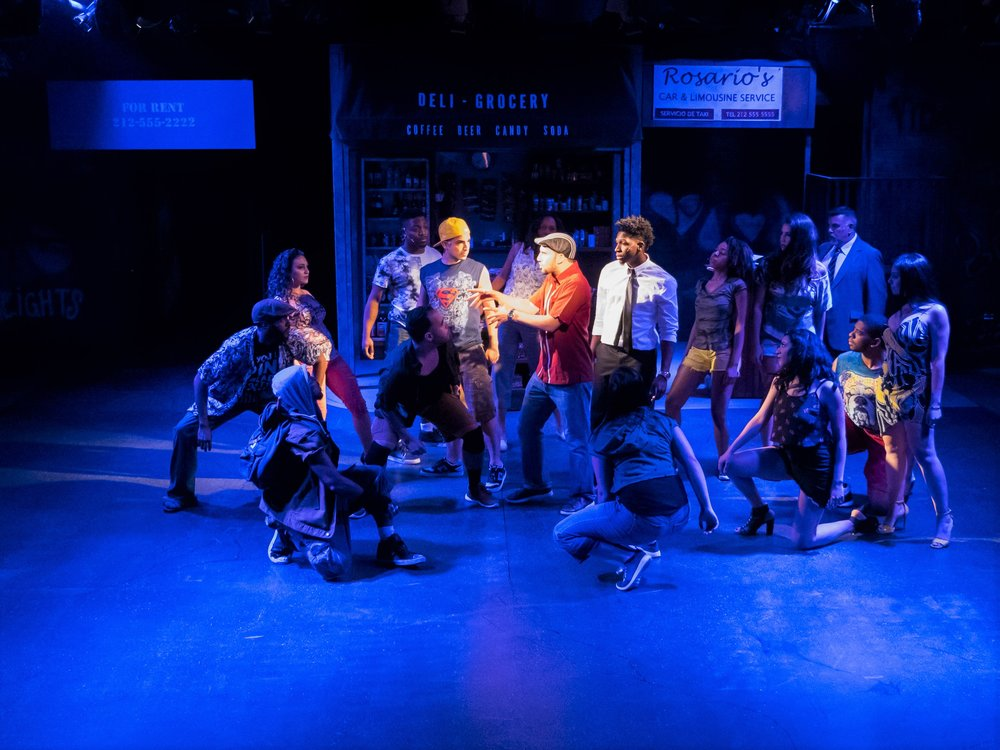 Usnavi de la Vega (Nikos Touros), center, and the cast of In the Heights at Playhouse on Park
