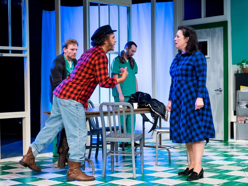 Randle Patrick McMurphy (Wayne Willinger) and Nurse Ratched (Patricia Randell), foreground; Dale Harding (Adam Kee), Ruckley (Ben McLauglin), background; in Playhouse on Park's production of One Flew Over the Cuckoo's Nest (photos by Curt Henderson)