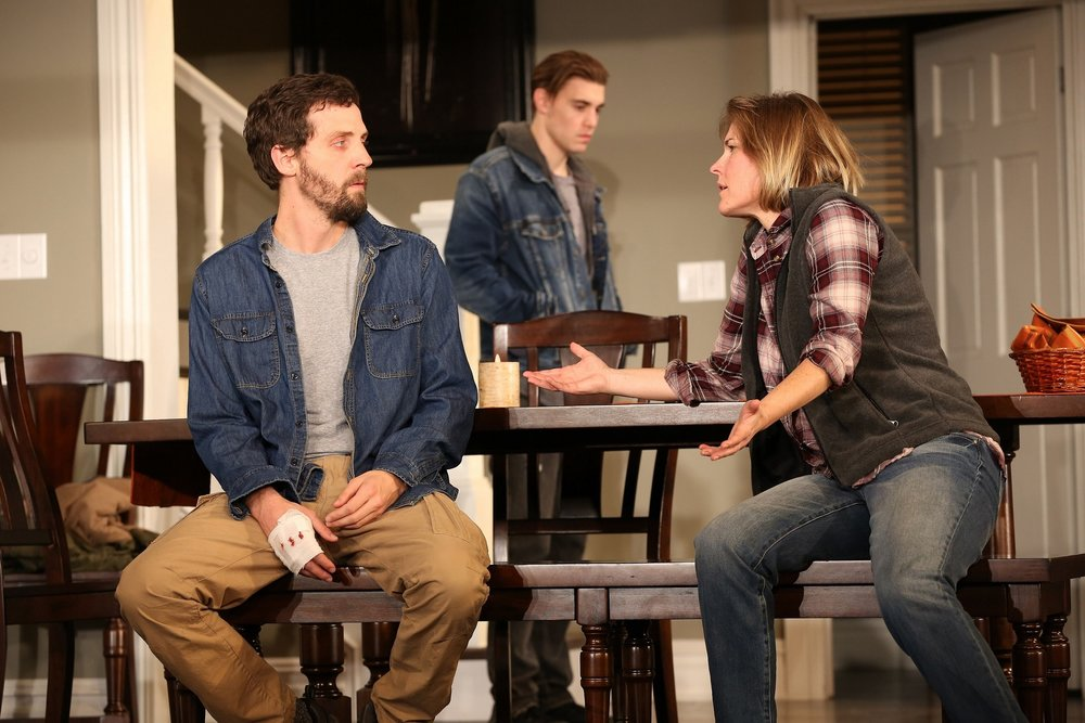 At the Garrisons: Joby Earle (Actor 4), Kelly McAndrew (Actor 1), foreground; Andrew Veenstra (Actor 6), background
