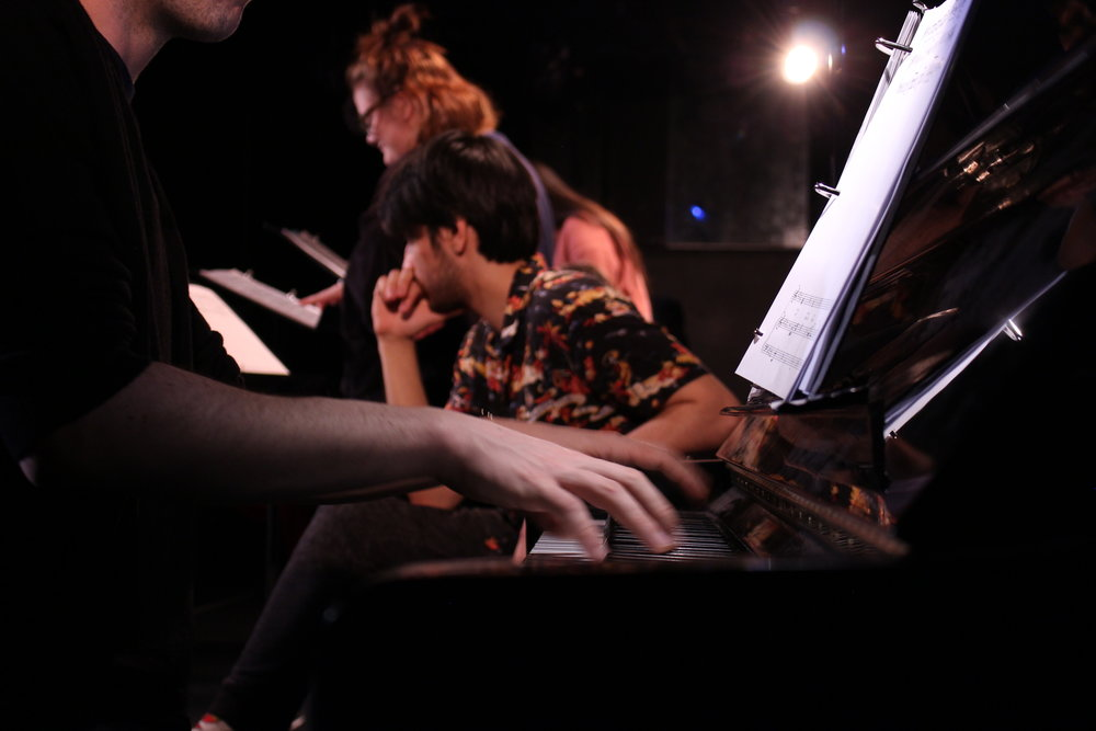 "Charlie Romano, foreground at piano; Dario Ladani Sánchez, Taylor Hoffman, background, ""UNAMUSED"""