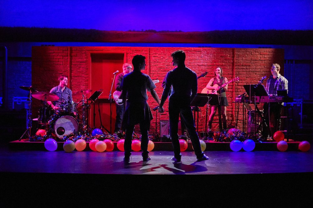 Will (David Merino), Mike (CJ Pawlikowski) and the band in Girlfriends, directed by Rob Ruggiero, at TheaterWorks, photos courtesy of TheaterWorks