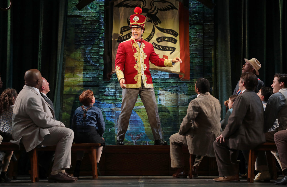 Harold Hill (Edward Watts), center, and the cast of The Goodspeed's production of The Music Man, directed by Jenn Thompson (photo by Diane Sobolewski)