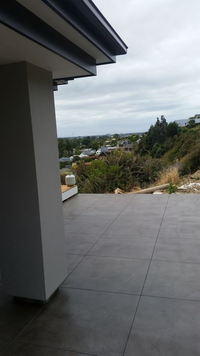 colour and cut concrete (bluestone colour) - patio - huntsbury_1.jpg