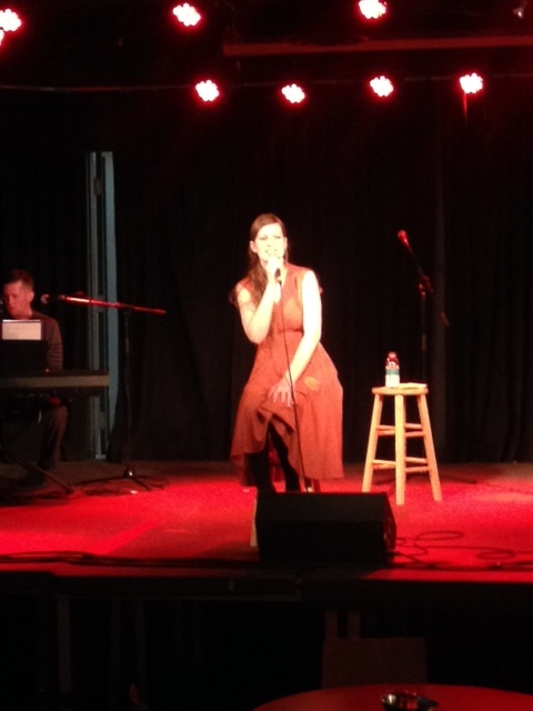 A blurry photo of me during my first solo produced show thanks to my mom's friend April!
