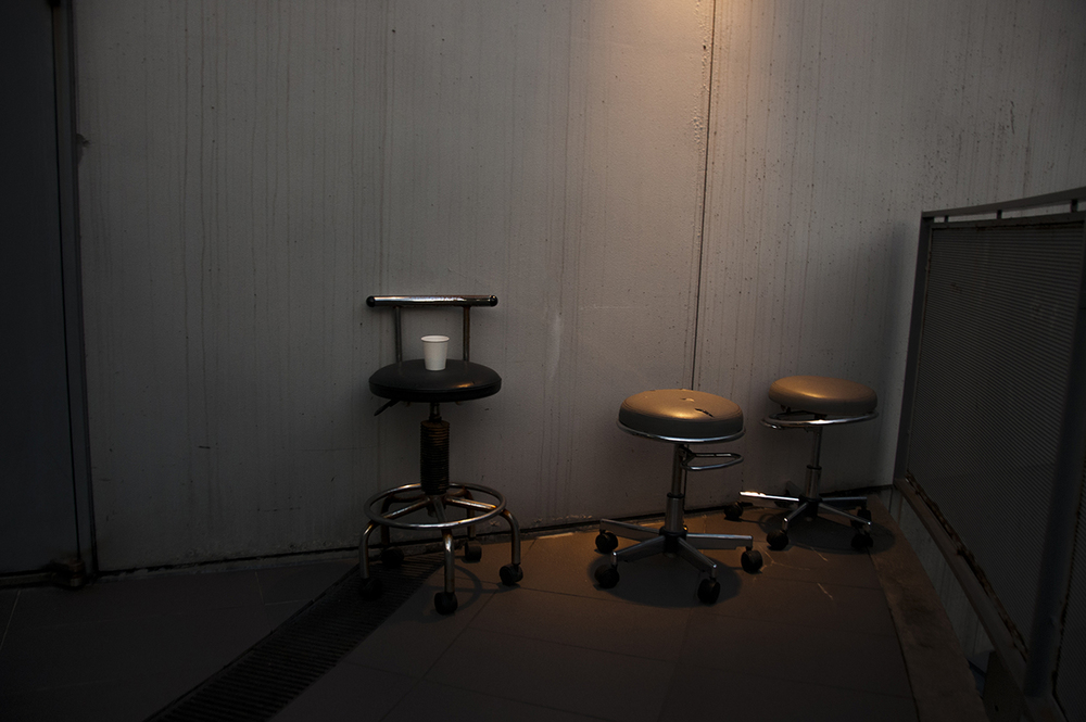 One cup, one chair, two stools.