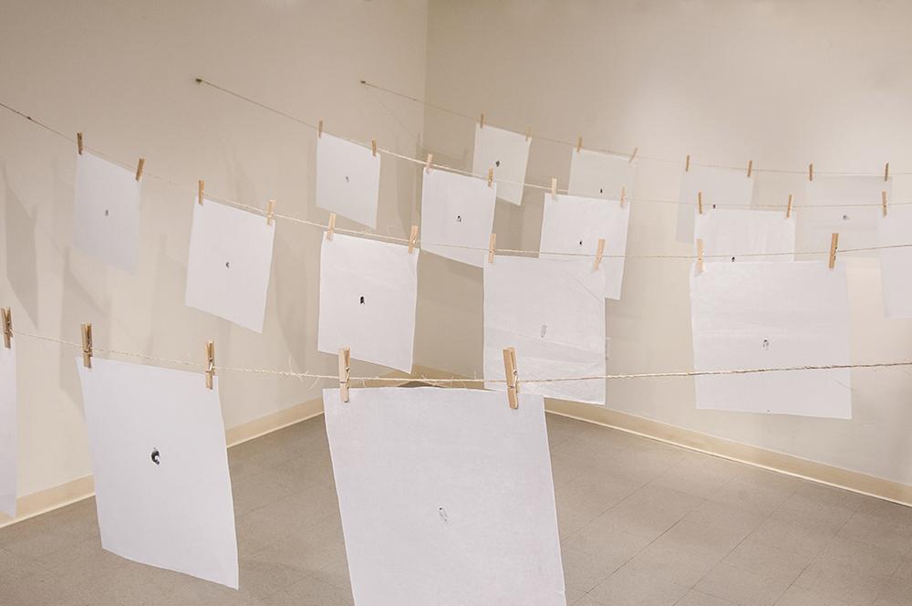지문 (jē•mōōn): Exploring Equality in South Korea.  Stamped ink thumbprints on mulberry fiber paper hung from twine and clothespins.