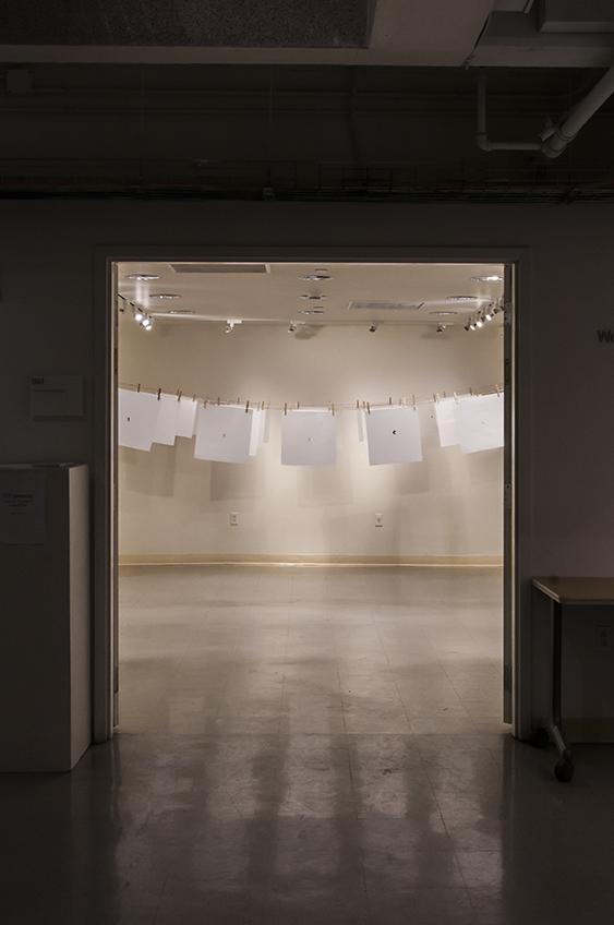 지문 (jē•mōōn): Exploring Equality in South Korea.  Ink prints on mulberry fiber paper hung from twine and clothespins.