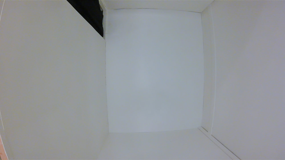 Marking. (FINAL state)  Multimedia installation: white painted constructed room.  96x125x96 inches.  Installation view.