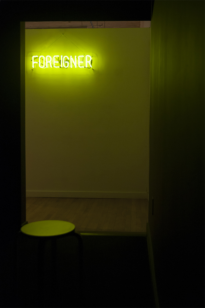 are you listening to me?  Multimedia installation: FOREIGNER neon sign, projector, and black box.   Installation view.