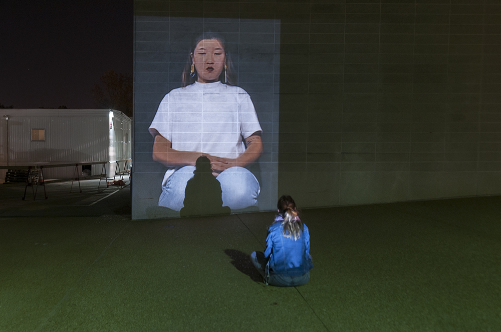 I Am Kneeling.  Public art installation of a 132 x 96 inch projection on the facade of Walker Hall at Washington University at St. Louis.  Installation view.