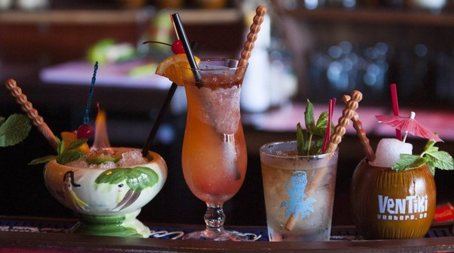 STAR FILE PHOTO Classic Polynesian cocktails are specialties of the house at Ventiki Tiki Lounge and Lanai in Ventura. The combination bar and restaurant is reopening after a 70-foot palm tree fell onto its patio during a Jan. 31 wind storm. Pieces of the palm tree's trunk will be carved into tikis.