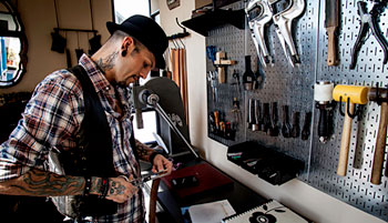 Anthony Valadez works on a belt in his downtown Ventura shop.