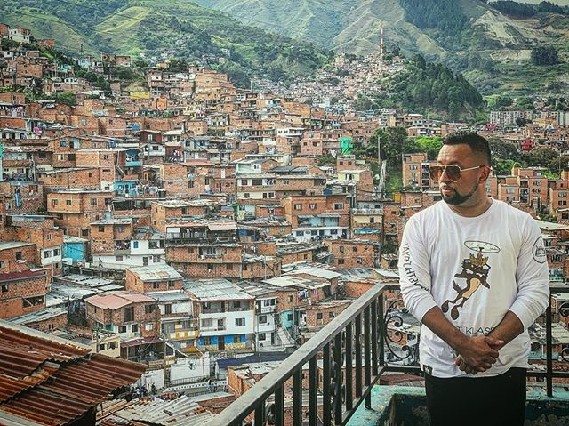 """🔥🌎 #CHASE 🌎🔥 . . . """"The most powerful weapon on earth is the human soul on fire."""" – Ferdinand Foch . . . 📸: @skill_flavor . . . 👕: @first_klassco . . . . #visionary #producer #traveler #medellin #colombia #favela #firstklassco ##explorer #sagittarius #slums #takeflightbyallmeans #multimedia #driven #passionate #creative #stylolive #onlocation #elparamparam #alimoña #apache #thatsawrap #la #living #life #BOOM"""