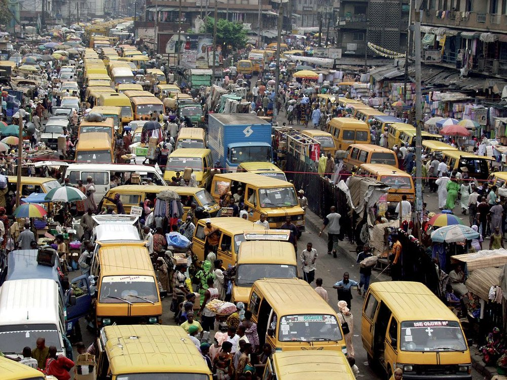 VIEW FROM ABOVE OF A TPICAL DAY AT A LAGOS BUSTOP